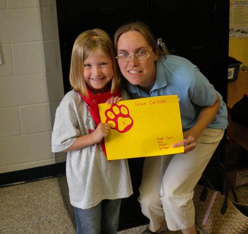 Michelle with Gracie at kindergarten graduation
